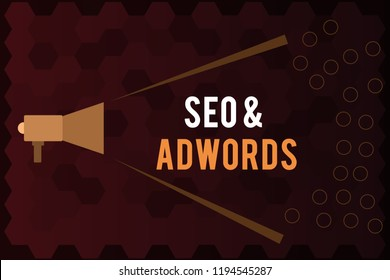 Handwriting text Seo and Adwords. Concept meaning Pay per click Digital marketing Google Adsense