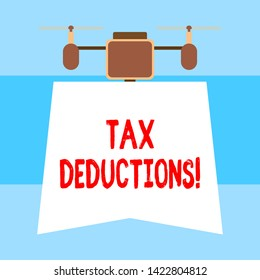 Handwriting text Tax Deductions. Concept meaning reduction income that is able to be taxed of expenses Drone holding downwards banner. Geometrical abstract background design.