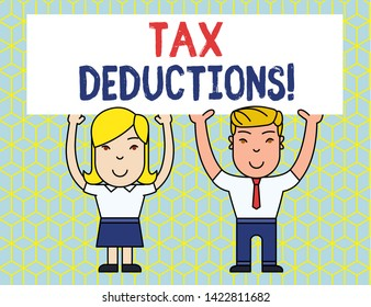 Handwriting text Tax Deductions. Concept meaning reduction income that is able to be taxed of expenses Two Smiling People Holding Big Blank Poster Board Overhead with Both Hands.