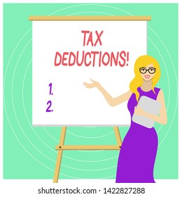 Handwriting text Tax Deductions. Concept meaning reduction income that is able to be taxed of expenses White Female in Glasses Standing by Blank Whiteboard on Stand Presentation.