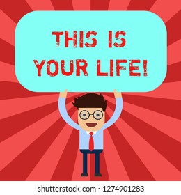 Handwriting text This Is Your Life. Concept meaning Motivation to do whatever you want empowerment vision Man Standing Holding Above his Head Blank Rectangular Colored Board.