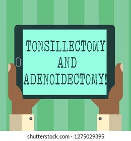 Handwriting text Tonsillectomy And Adenoidectomy. Concept meaning Procedure in removing tonsil and adenoid Hu analysis Hand Holding Blank Screen Tablet Smartphone Display Unit photo.