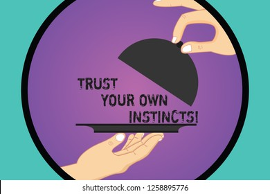 Handwriting text Trust Your Own Instincts. Concept meaning Intuitive follow demonstratingal feelings confidence Hu analysis Hands Serving Tray Platter and Lifting the Lid inside Color Circle.