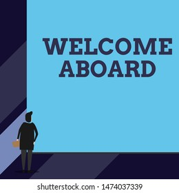 Handwriting text Welcome Aboard. Concept meaning Expression of greetings to a demonstrating whose arrived is desired Back view young woman watching blank big rectangle. Geometrical background.