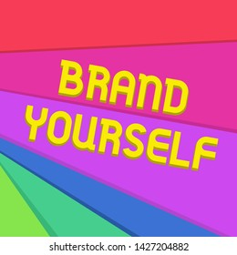 Handwriting text writing Brand Yourself. Concept meaning Develop a unique professional identity Personal product Multicolor Sheets of Cardboard Paper of Different Colors Placed Randomly.