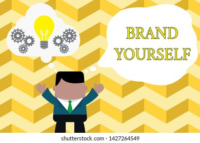 Handwriting text writing Brand Yourself. Concept meaning Develop a unique professional identity Personal product Standing man suit hands up imaginary bubble light bulb gears working together.