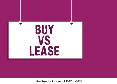 Handwriting text writing Buy Vs Lease. Concept meaning Own something versus borrow it Advantages Disadvantages Hanging board message communication open close sign purple background.