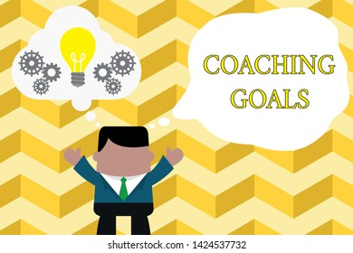 Handwriting text writing Coaching Goals. Concept meaning Empowers individuals Encourages them to take responsibility Standing man suit hands up imaginary bubble light bulb gears working together.