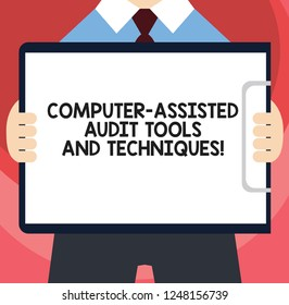 Handwriting text writing Computer Assisted Audit Tools And Techniques. Concept meaning Modern auditing applications Man in Suit Standing Holding Horizontally Clipboard with Blank Paper.