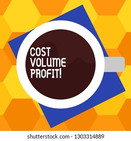Handwriting text writing Cost Volume Profit. Concept meaning form of cost accounting and It is simplified model Top View of Drinking Cup Filled with Beverage on Color Paper photo.