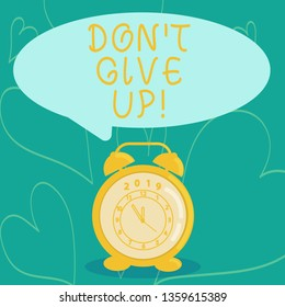 Handwriting text writing Don T Give Up. Concept meaning you should continue doing what you are good at Resist Round Blank Speech Balloon in Pastel Shade and Colorful Analog Alarm Clock.