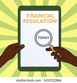 Handwriting text writing Financial Regulation. Concept meaning aim to Maintain the integrity of Finance System Hands Holding Magnifying Glass Against Switched Off Touch Screen Tablet.