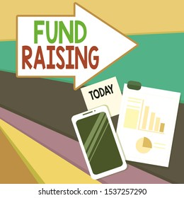 Handwriting text writing Fund Raising. Concept meaning the act of seeking to generate financial support for a charity Layout Smartphone Off Sticky Notes Clipboard with Pie Chart and Bar Graph.
