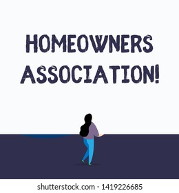 Handwriting text writing Homeowners Association. Concept meaning Organization with fee for upkeeps of Gated Community Back view young long hair woman holding blank square announcement design.