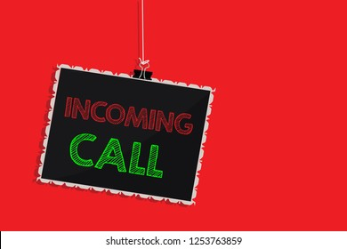 Handwriting text writing Incoming Call. Concept meaning Inbound Received Caller ID Telephone Voicemail Vidcall Hanging blackboard message communication information sign red background.