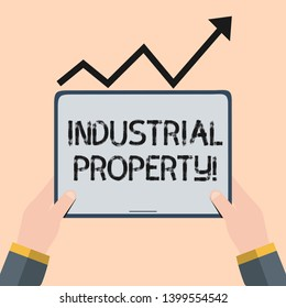 Handwriting text writing Industrial Property. Concept meaning the intangible ownership of a trademark or patent Hand Holding Blank Screen Tablet under Black Progressive Arrow Going Upward.
