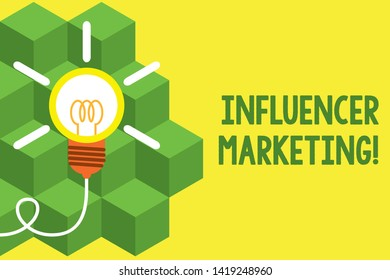 Handwriting text writing Influencer Marketing. Concept meaning Endorser who Influence Potential Target Customers Big idea light bulb. Successful turning idea invention innovation. Startup.