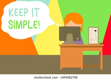 Handwriting text writing Keep It Simple. Concept meaning ask something easy understand not go into too much detail Young female working office sitting desktop computer office monitor photo.