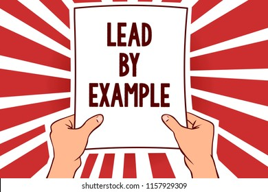 Handwriting text writing Lead By Example. Concept meaning Be a mentor leader follow the rules give examples Coach Man holding paper important message remarkable red rays enlighten ideas.