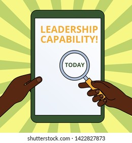 Handwriting text writing Leadership Capability. Concept meaning what a Leader can build Capacity to Lead Effectively Hands Holding Magnifying Glass Against Switched Off Touch Screen Tablet.