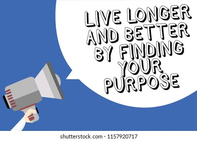 Handwriting text writing Live Longer And Better By Finding Your Purpose. Concept meaning Look for a goal set mission Man holding megaphone loudspeaker speech bubble message blue background.