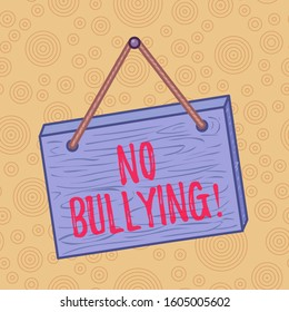 Handwriting text writing No Bullying. Concept meaning stop aggressive behavior among children power imbalance Square rectangle unreal cartoon wood wooden hang down on the coloured wall.