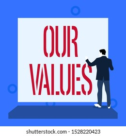 Handwriting text writing Our Values. Concept meaning list of morals companies or individuals commit to do them Back view young man dressed suit standing platform facing blank rectangle.
