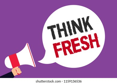 Handwriting text writing Think Fresh. Concept meaning Thinking on natural ingredients Positive good environment Man holding megaphone loudspeaker speech bubble screaming purple background.