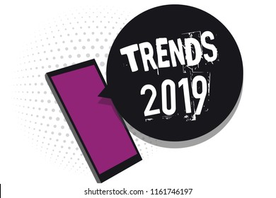 Handwriting text writing Trends 2019. Concept meaning Upcoming year prevailing tendency Widely Discussed Online Cell phone receiving text messages chats information using applications.