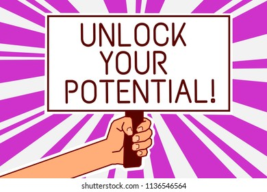 Handwriting text writing Unlock Your Potential. Concept meaning improve self awareness Skills to Achieve more Man hand holding poster important protest message purple rays background.