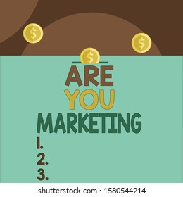 Handwriting text Are You Marketing. Concept meaning Actions to promote brand product Sales in market Front view close up three penny coins icon one entering collecting box slot.