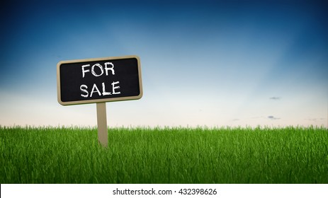 Handwritten chalk For Sale sign on a slate signboard on a green grassy plot of land or meadow under a graduated blue sky with copy space in a panoramic banner format. 3d Rendering.