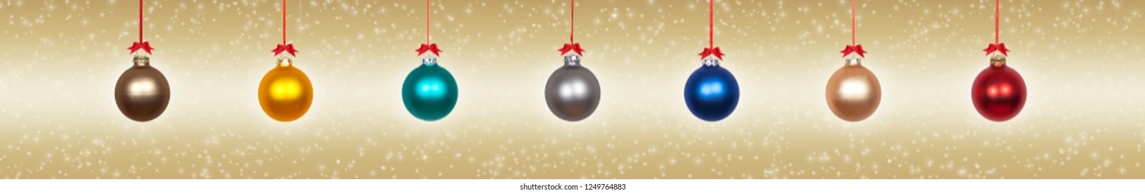 Hanging christmas balls on a golden background