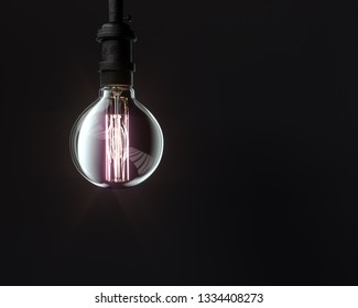 Hanging glowing Edison lamp isolated on black background, Idea technology and science concept, 3d rendering