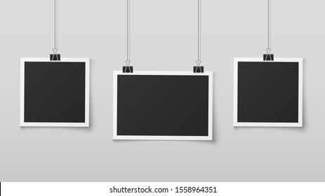 Hanging photo frames. Blank photos frame hangs on ropes with clips, wall memory, retro image memories album. Realistic design isolated empty square picture or foto