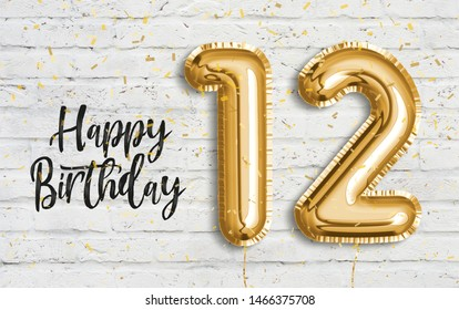 Happy 12th birthday gold foil balloon greeting white wall background. 12 years anniversary logo template- 12th celebrating with confetti. Photo stock.