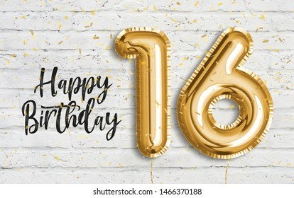 Happy 16th birthday gold foil balloon greeting white wall background. 16 years anniversary logo template- 16th celebrating with confetti. Photo stock.