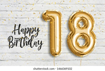 Happy 18th birthday gold foil balloon greeting white wall background. 18 years anniversary logo template- 18th celebrating with confetti. Photo stock.