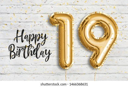 Happy 19th birthday gold foil balloon greeting white wall background. 19 years anniversary logo template- 19th celebrating with confetti. Photo stock.