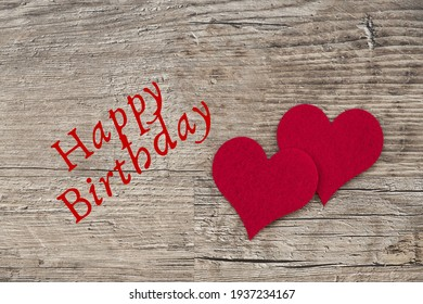Happy Birthday in wooden board and two heart.