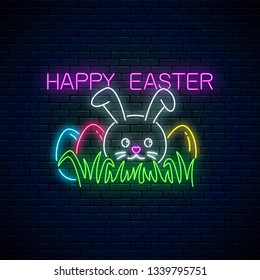 Happy easter glowing signboard with bunny and colored eggs on grass in neon style. Easter funny greeting banner.