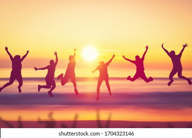 Happy friend jumping at tropical sunset beach background. Copy space of friendship freedom vacation and travel holiday teamwork concept. Vintage tone filter effect color style.