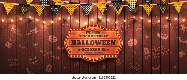Happy Halloween background with string light and Halloween buntings on wood background.Website spooky or banner template