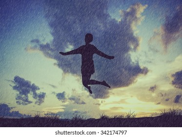 Happy lady jumping,dancing with rain.