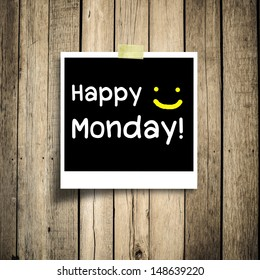 Happy Monday on grunge wooden background with copy space