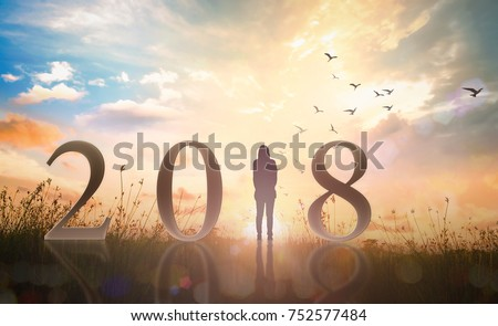 happy new year concept alone woman and text for 2018 over heaven of god background