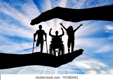 Happy people with disabilities in the hands, under the protection and tutelage. The concept of assistance and the care of disabled