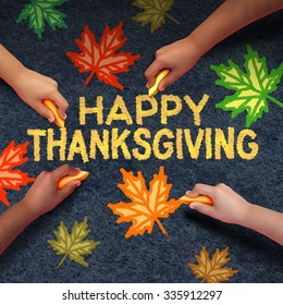 Happy thanksgiving day concept as a group of diverse people drawing using chalk on asphalt the word for traditional family get together during autumn season and community fall celebration..