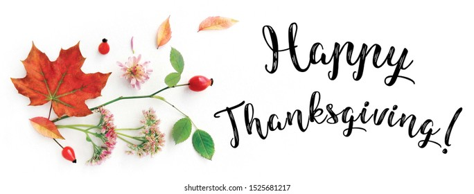 Happy Thanksgiving facebook cover for web page, site banner template. Collage of handwritten font, autumn branch of wild rose, berries and leaves, flowers on white background. Flat lay, top view.