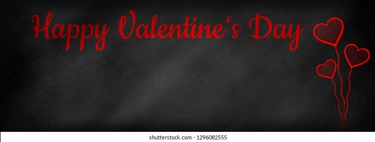 Happy Valentine's Day written on a panoramic chalkboard